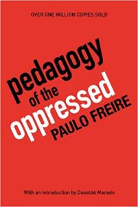 Red background with the text: Pedagogy of the oppressed, Paulo Freire
