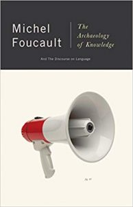 White background with a megaphone with words Michel Foucault