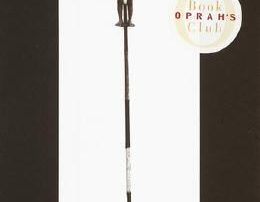 A young child balanced atop a pole. Oprah's book club logo and the text A Fine Balance at the bottom.
